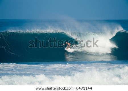 professional surfer at a contest (for editorial use only) - stock photo