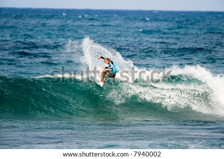 professional surfer in Pipeline masters contest (for editorial use only)