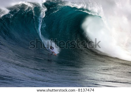 Professional surfing at Jaws, the world's largest wave - stock photo