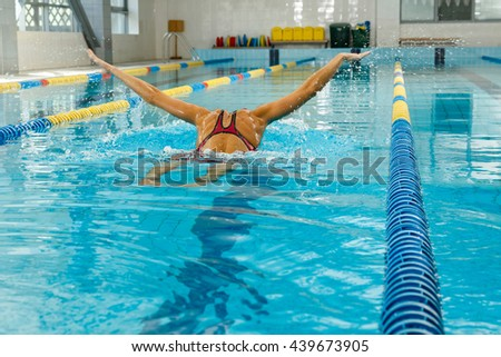 Professional swimmer in the pool