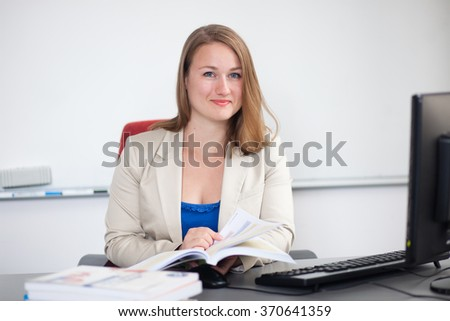Professional teacher/instructor at work - stock photo