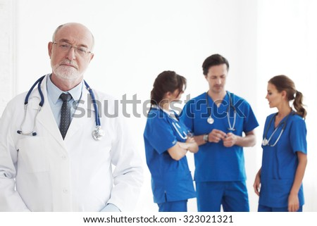 Professional team of doctors and nurses on white background