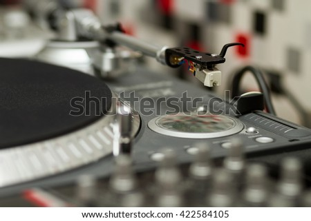 Professional turntable record player. Analog sound equipment for DJ, nightclub or audio enthusiast. Focus on the needle - stock photo