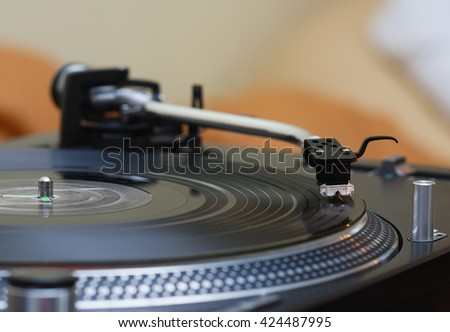 Professional turntable record player. Analog technology for DJ, concert, nightclub, event. Close up on needle and vinyl disc. - stock photo
