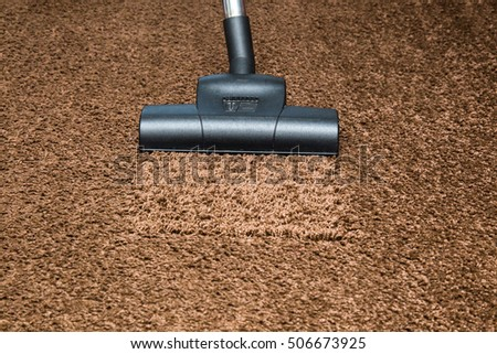 Professional vacuum cleaner turbo brush frees the carpet from dust. Early spring cleaning or regular clean up.