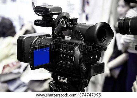 Professional video camcorder on field - stock photo