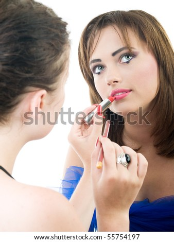 professional visage artist applying makeup to a model - stock photo