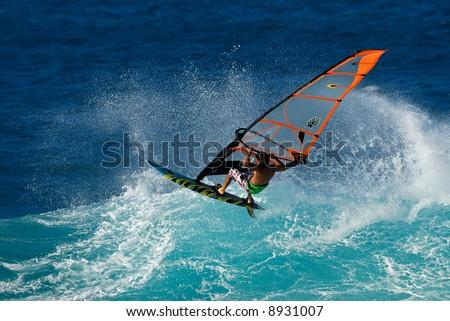 Professional Windsurfing on big waves in Maui, Hawaii - stock photo