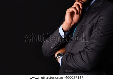 Professional with thinking gesture isolated on black - stock photo