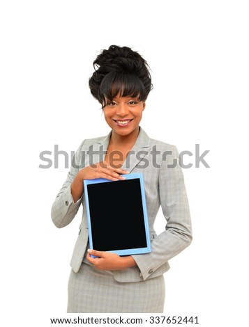 Professional woman holding tablet in blue casing smiling at camera isolated on gray background - stock photo