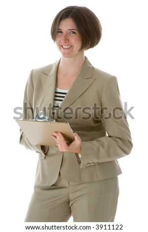 Professional woman in business suit holding a clipboard and giving a friendly smile toward the viewer. Isolated on white.