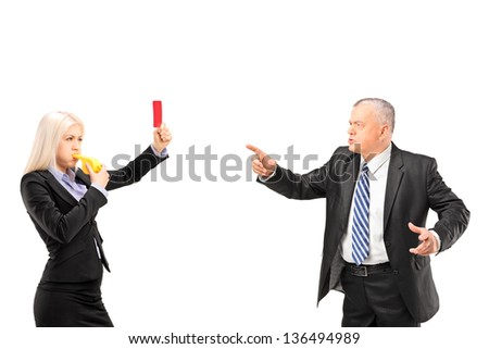 Professional woman showing a red card and blowing a whistle to her boss, isolated on white background - stock photo