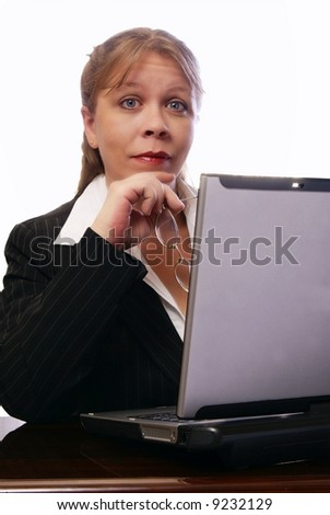 Professional woman working on convertible notebook laptop computer looking at viewer with raised eyebrows. Natural look with minimal makeup.