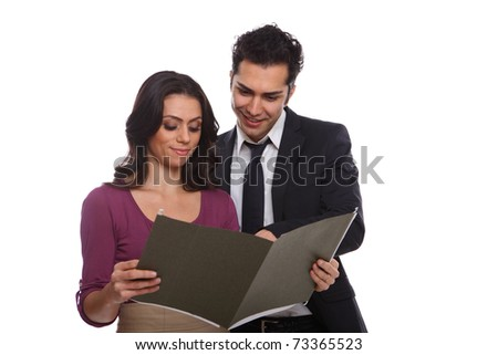 Professional workers looking at a document isolated on white - stock photo