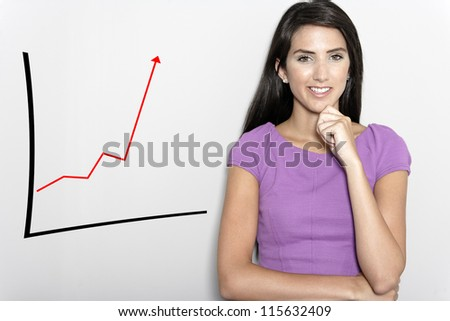 Professional working woman in corporate purple dress, with a concept graph displaying an increase. - stock photo