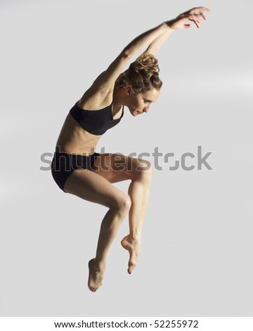 professional young ballerina jumping in air