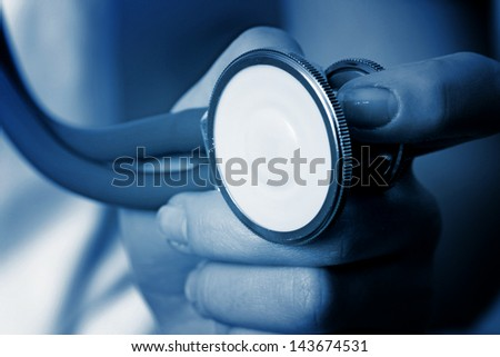 Professional young doctor at work. Close up. - stock photo