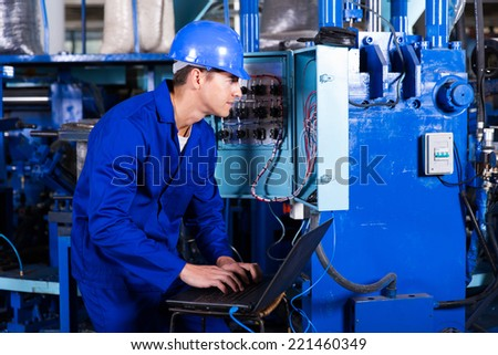 professional young electrician analyzing data on his laptop - stock photo