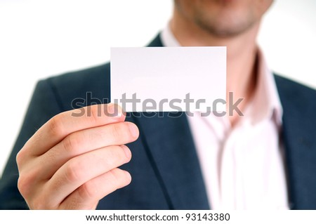 Professional young man holding business card - stock photo