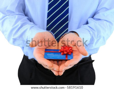 Professionally dressed businessman is giving a present credit car - stock photo