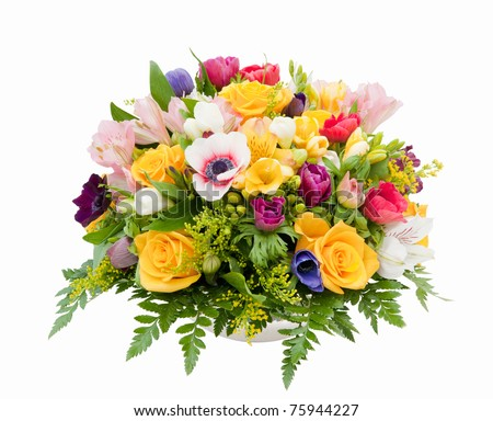 Professionally prepared decorative spring flower arrangement against white background - stock photo