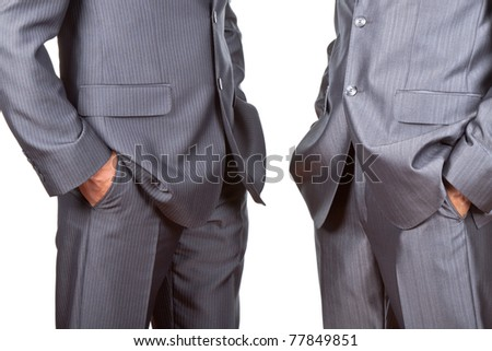 Professionally well dressed two caucasian businessmen in elegant suits, top managers standing holding hands in pockets isolated on white background. Concept corporate. - stock photo