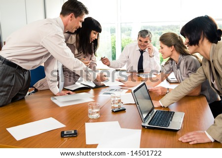 Professionals gathered together and discussing ideas at seminar - stock photo