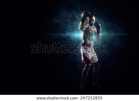 Professionl boxer is standing in the spotlight - stock photo