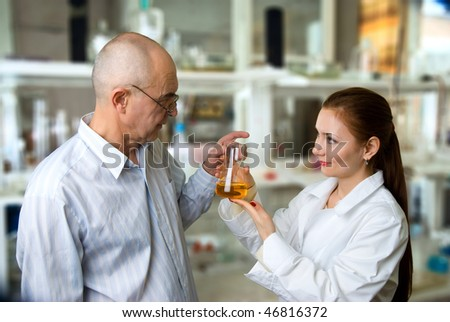 professor and his assistant in the chemical laboratory experiments have been successful - stock photo