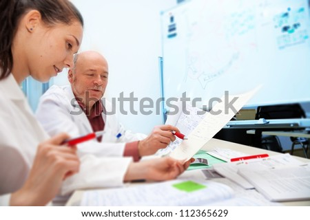 Professor and student medical school - stock photo