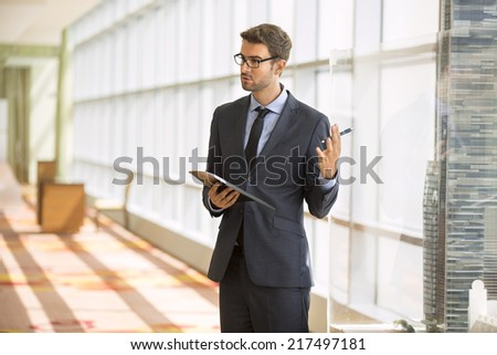 Professor giving a presentation in a conference/meeting room - stock photo