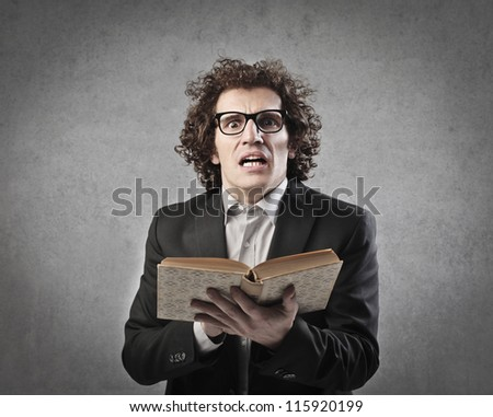 Professor telling a story from a book - stock photo