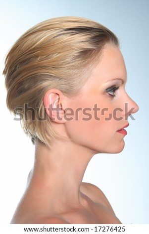 Profile beauty portrait of a blond caucasian female model. - stock photo