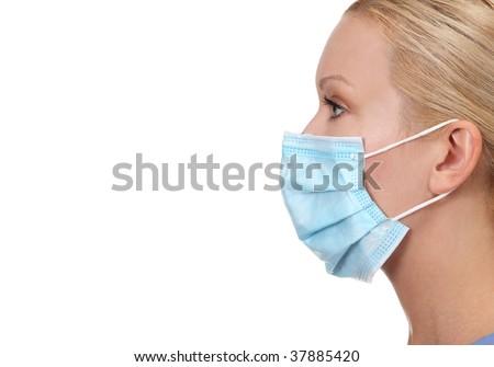 Profile image of young female nurse wearing face mask isolated on white - stock photo