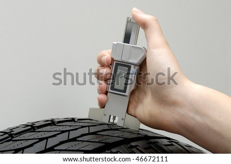 Profile measuring at a car tire - stock photo