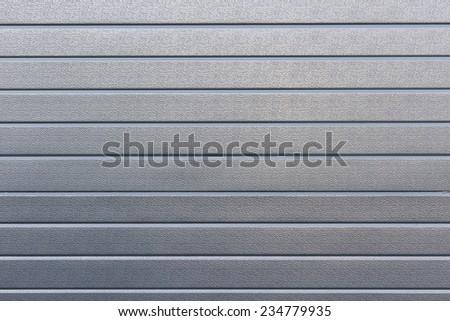 Profile metallic background ,fragment of steel doors - stock photo