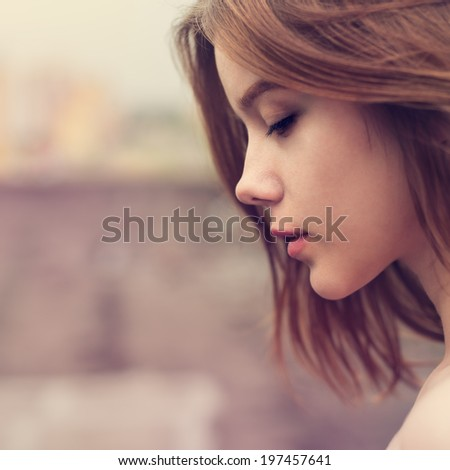 Profile of a beautiful girl closeup - stock photo