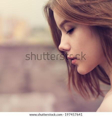 Profile of a beautiful girl closeup - stock photo