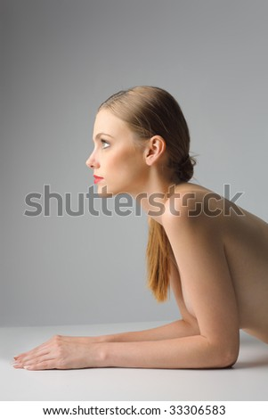 profile of  a beautiful woman naked - stock photo
