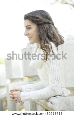 Profile of a Beautiful Young Woman Leaning on a Railing