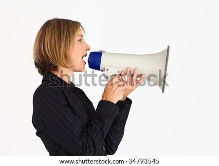 Profile of a businesswoman shouting through a megaphone