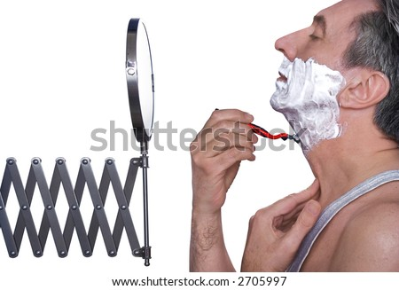 Profile of a gray-haired male shaving - stock photo