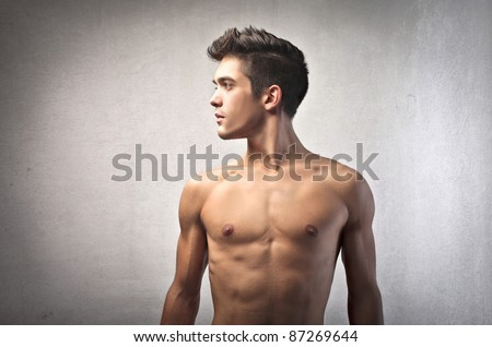 Profile of a handsome bare-chested man - stock photo