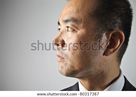 Profile of a japanese businessman - stock photo