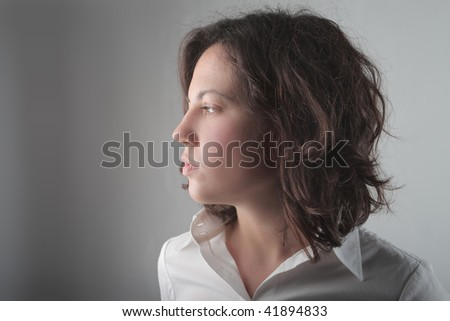 profile of a serious girl - stock photo