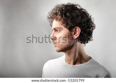 Profile of a serious man - stock photo
