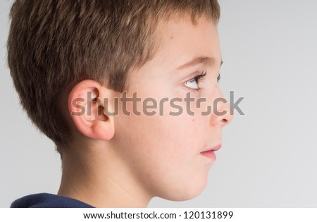 Profile of a six years old boy - stock photo