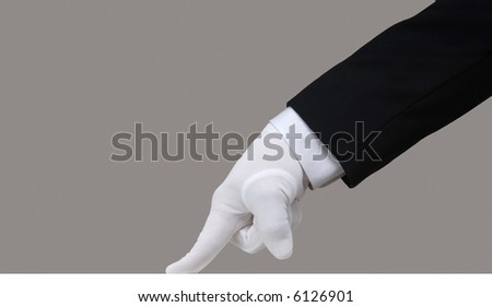 Profile of a white glove running a finger across a clean surface - stock photo