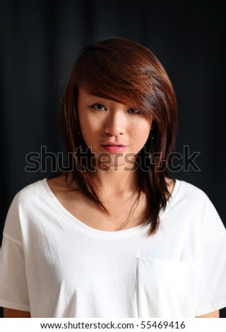 profile of a young asian girl in a studio - stock photo