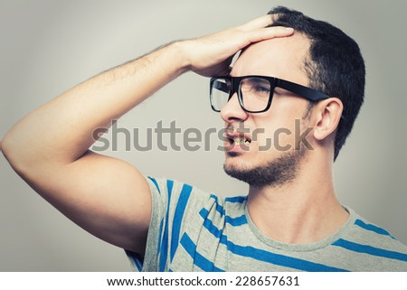 profile of a young business man thinking - stock photo